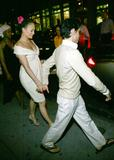 Jennifer Lopez shows cleavage in white dress in New York City